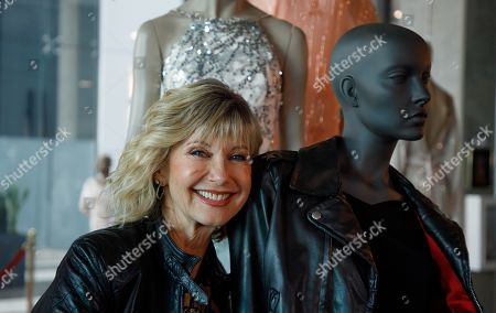 Olivia Newton-John poses with items from her auction at Julien's Auctions in Beverly Hills, California, USA, 28 October 2019 (issued 29 October 2019). Property from 'The Collection of Olivia Newton-John' includes over 500 costumes, gowns and other personal items for the event on 01-02 November 2019.