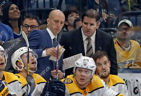 Nashville Predators head coach Peter Laviolette, right, and assistant coach Dan Muse during the third period of an NHL hockey game against the Tampa Bay Lightning, in Tampa, Fla