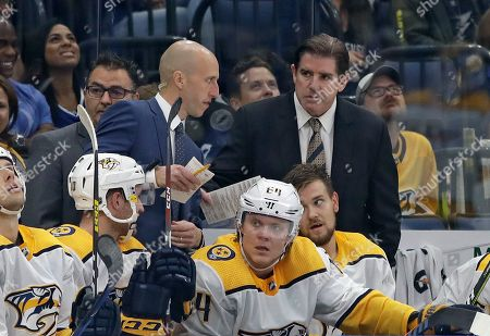Nashville Predators head coach Peter Laviolette, right, talks to assistant coach Dan Muse during the third period of an NHL hockey game against the Tampa Bay Lightning, in Tampa, Fla