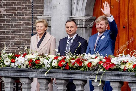 Dutch King Willem-Alexander (R), Polish President Andrzej Duda (C) and his wife Agata Kornhauser-Duda watch a parade in Breda, Netherlands, 29 October 2019. The king and the president attended the celebration of 75 years of liberation of Breda.