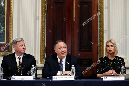 John Richmond, Secretary of State Mike Pompeo and Ivanka Trump listen during a meeting of the President's Interagency Task Force to Monitor and Combat Trafficking in Persons (PITF), in the Eisenhower Executive Office Building, on the White House complex, in Washington