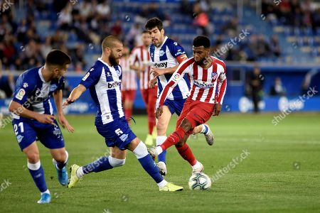 Atletico de Madrid's winger Thomas Lemar (R) in action against Deportivo Alaves' defender Victor Laguardia (2-L) during the Spanish LaLiga soccer match between CD Alaves and Atletico de Madrid at Mendizorroza stadium in Vitoria, Basque Country, Spain, 29 October 2019.