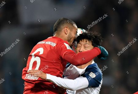 Stock Picture of Bayern's Thiago, left, jumps for a header with Bochum's Chung-Yong Lee during the German soccer cup, DFB Pokal, second round match between VfL Bochum and Bayern Munich at the Vonovia Ruhrstadion stadium, in Bochum, Germany