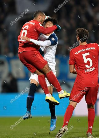 Bayern's Thiago, left, jumps for a header with Bochum's Chung-Yong Lee during the German soccer cup, DFB Pokal, second round match between VfL Bochum and Bayern Munich at the Vonovia Ruhrstadion stadium, in Bochum, Germany