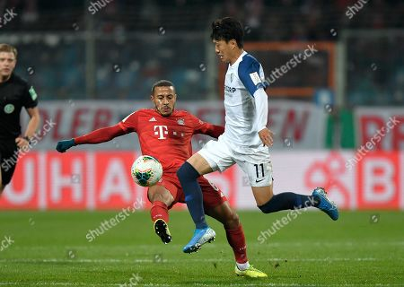 Bochum's Chung-Yong Lee, right, challenges for the ball with Bayern's Thiago during the German soccer cup, DFB Pokal, second round match between VfL Bochum and Bayern Munich at the Vonovia Ruhrstadion stadium, in Bochum, Germany