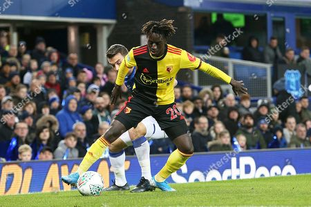 Watford midfielder Domingos Quina (20) fends off the challenge from Everton defender Seamus Coleman (23) during the EFL Cup match between Everton and Watford at Goodison Park, Liverpool