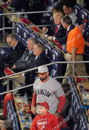 Stock Photo of Actor Dave Bautista, bottom center, stands up between innings in a suite next to where President Donald Trump, top third from the right, and other Republican lawmakers are seated during Game 5 of the baseball World Series between the Houston Astros and the Washington Nationals, in Washington. Also seen are from l-r., Rep. Andy Biggs, R-Ariz., Rep. Mark Meadows, R-NC., Sen. Lindsey Graham, R-S.C., first lady Melania Trump and Sen. David Perdue, R-Ga