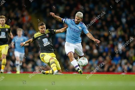 Sergio Aguero of Manchester City and Jan Bednarek of Southampton F.C. challenge for the ball during the EFL Cup match between Manchester City and Southampton at the Etihad Stadium, Manchester