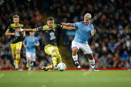 Stock Photo of Sergio Aguero of Manchester City and Jan Bednarek of Southampton F.C. challenge for the ball during the EFL Cup match between Manchester City and Southampton at the Etihad Stadium, Manchester