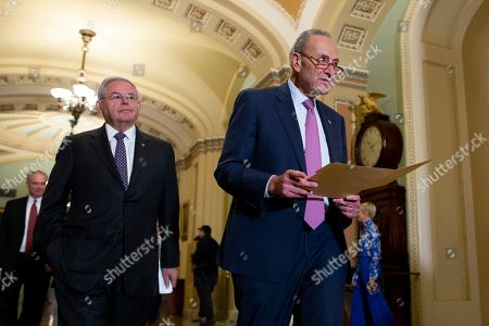 Democratic Sentor from New Jersey Bob Menendez (L) and Senate Minority Leader Democrat Chuck Schumer (R) arrive for a news conference on Capitol Hill in Washington, DC, USA, 29 October 2019. Senate Democrats used the opportunity to discuss Syria - applauding the death of the caliph of the self-proclaimed Islamic State, Abu Bakr al-Baghdadi; and criticized US President Donald J. Trump for thanking Russia and downplaying the Kurdish role in Baghdadi's death.
