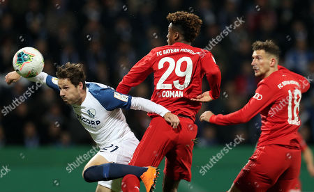 Bochum's Stefano Celozzi (L) in action against Bayern's Kingsley Coman (C) and Bayern's Leon Goretzka (R) during the German DFB Cup second round soccer match between VfL Bochum and FC Bayern Muenchen in Bochum, Germany, 29 October 2019.