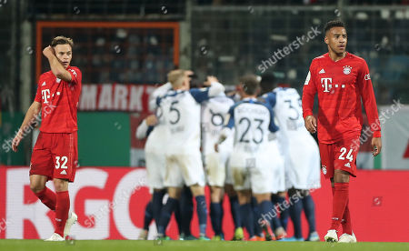 Stock Photo of Bayern's Joshua Kimmich (L) and Bayern's Corentin Tolisso (R) reacts after Bochum's first goal during the German DFB Cup second round soccer match between VfL Bochum and FC Bayern Muenchen in Bochum, Germany, 29 October 2019.