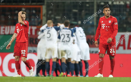 Bayern's Joshua Kimmich (L) and Bayern's Corentin Tolisso (R) reacts after Bochum's first goal during the German DFB Cup second round soccer match between VfL Bochum and FC Bayern Muenchen in Bochum, Germany, 29 October 2019.
