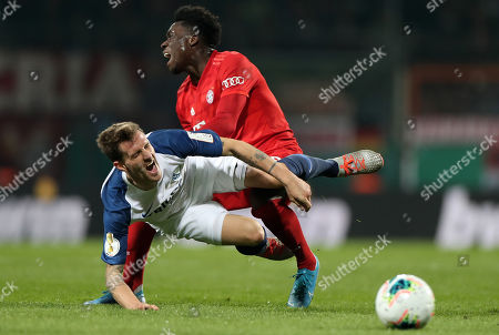 Stock Photo of Bayern's Alphonso Davies (R) in action against Bochum's Simon Zoller (L) during the German DFB Cup second round soccer match between VfL Bochum and FC Bayern Muenchen in Bochum, Germany, 29 October 2019.
