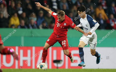 Bayern's Joshua Kimmich (L) in action against Bochum's Chung Yong Lee (R) during the German DFB Cup second round soccer match between VfL Bochum and FC Bayern Muenchen in Bochum, Germany, 29 October 2019.