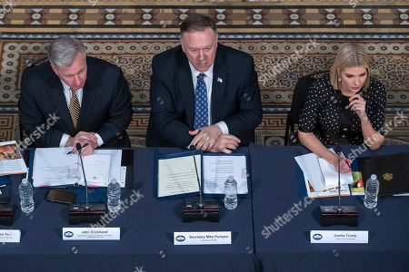 US Secretary of State Mike Pompeo (C), Ambassador-at-Large to Monitor and Combat Trafficking in Persons John Richmond (L) and Presidential advisor Ivanka Trump (R) attend the President's Interagency Task Force to Monitor and Combat Trafficking in Persons (PITF) attend a meeting in the Indian Treaty Room of the Eisenhower Executive Office Building on the White House complex in Washington, DC, USA, 29 October 2019. The Cabinet-level entity created by the Trafficking Victims Protection Act of 2000, aims to coordinate efforts to combat human trafficking.
