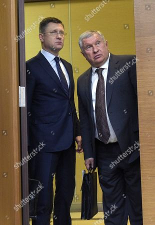 Russian Minister of Energy Alexander Novak (left) and Chief Executive Officer, Chairman of the Board of Rosneft Igor Sechin (right) before the meeting in the Novo-Ogaryovo residence in Moscow.