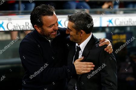Barcelona's head coach Ernesto Valverde, right, greets Valladolid's head coach Sergio Gonzalez during the Spanish La Liga soccer match between FC Barcelona and Valladolid CF at the Camp Nou stadium in Barcelona, Spain