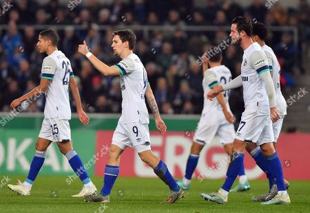 (L-R) Schalke's Amine Harit, Benito Raman and Mark Uth during the German DFB Cup second round soccer match between Arminia Bielefeld and FC Schalke 04 in Bielefeld, Germany, 29 October 2019.