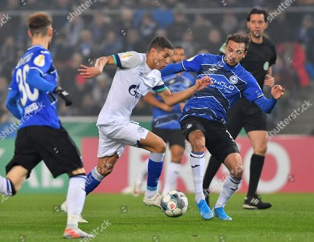 Bielefeld's Manuel Prietl (R) in action against Schalke's Amine Harit (C) during the German DFB Cup second round soccer match between Arminia Bielefeld and FC Schalke 04 in Bielefeld, Germany, 29 October 2019.
