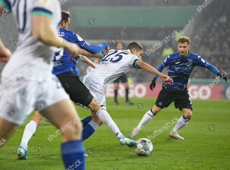 Bielefeld's Manuel Prietl (L) in action against Schalke's Amine Harit (C)  during the German DFB Cup second round soccer match between Arminia Bielefeld and FC Schalke 04 in Bielefeld, Germany, 29 October 2019.