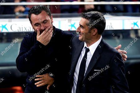 FC Barcelona's head coach Ernesto Valverde (R) greets Real Valladolid's head coach Sergio Gonzalez prior to a Spanish LaLiga soccer match between FC Barcelona and Real Valladolid at the Camp Nou stadium in Barcelona, Spain, 29 October 2019.