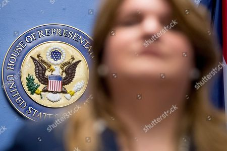 Resident Commissioner Jenniffer Gonzalez-Colon, foreground, who represents Puerto Rico as a nonvoting member of Congress, speaks about Puerto Rico statehood during a news conference on Capitol Hill in Washington