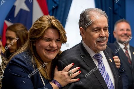 Jenniffer Gonzalez-Colon, Jose Serrano. Rep. Jose Serrano, D-N.Y., gets a hug from Resident Commissioner Jenniffer Gonzalez-Colon, left, who represents Puerto Rico as a nonvoting member of Congress, as he speaks about Puerto Rico statehood during a news conference on Capitol Hill in Washington