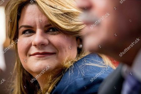 Resident Commissioner Jenniffer Gonzalez-Colon, who represents Puerto Rico as a nonvoting member of Congress, smiles at a news conference about Puerto Rico statehood on Capitol Hill in Washington