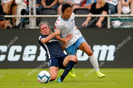 Y?ki Nagasato, Heather O'Reilly. Chicago Red Stars' Y?ki Nagasato (12) gets tangled up with North Carolina Courage's Heather O'Reilly (17) during the first half of the NWSL championship soccer game in Cary, N.C