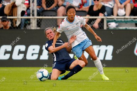 Stock Image of Y?ki Nagasato, Heather O'Reilly. Chicago Red Stars' Y?ki Nagasato (12) gets tangled up with North Carolina Courage's Heather O'Reilly (17) during the first half of the NWSL championship soccer game in Cary, N.C