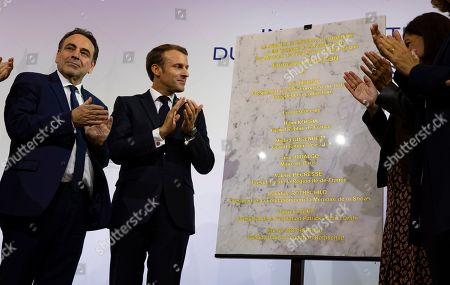 French President Emmanuel Macron (R) and  President of the Central Jewish Consistory of Paris Joel Mergui (L) inaugurate a plaque at the the Centre Europeen Du Judaisme (European Judaism Center), in Paris, France, 29 October 2019.