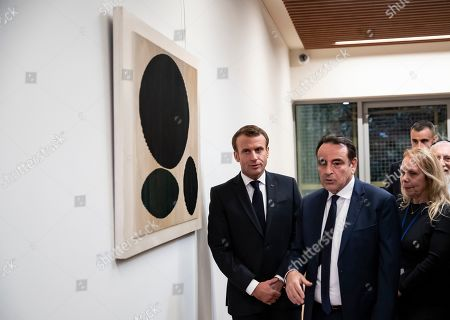 French President Emmanuel Macron (L) and  President of the Central Jewish Consistory of Paris Joel Mergui (2-L) visit the the Centre Europeen Du Judaisme (European Judaism Center) during its inauguration, in Paris, France, 29 October 2019.