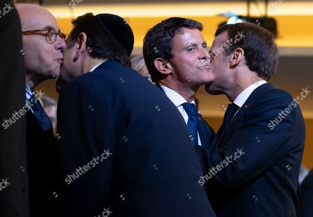 French President Emmanuel Macron (R) embraces Former French Prime Minister Manuel Valls (2-R), as President of the Central Jewish Consistory of Paris Joel Mergui (2-L) embraces former French Interior Minister Bernard Cazeneuve (L), during the official inauguration of the Centre Europeen Du Judaisme (European Judaism Center), in Paris, France, 29 October 2019.