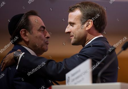 French President Emmanuel Macron (R) embraces President of the Central Jewish Consistory of Paris Joel Mergui (L) at the official inauguration of the Centre Europeen Du Judaisme (European Judaism Center), in Paris, France, 29 October 2019.