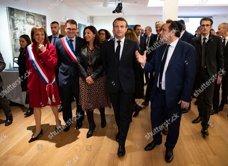 French President Emmanuel Macron (C) and  President of the Central Jewish Consistory of Paris Joel Mergui (R) visit the the Centre Europeen Du Judaisme (European Judaism Center) during its inauguration, in Paris, France, 29 October 2019.