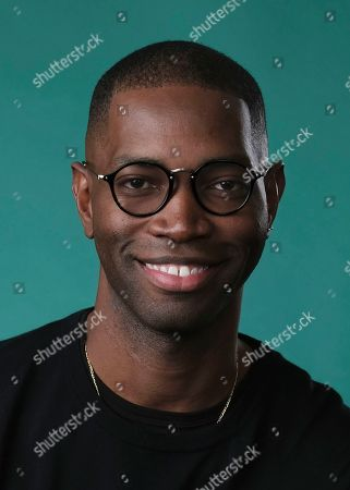 """In this July, 26 photo, Tarell Alvin McCraney, creator/executive producer of the OWN series """"David Makes Man,"""" poses for a portrait during the 2019 Television Critics Association Summer Press Tour at the Beverly Hilton in Beverly Hills, Calif"""