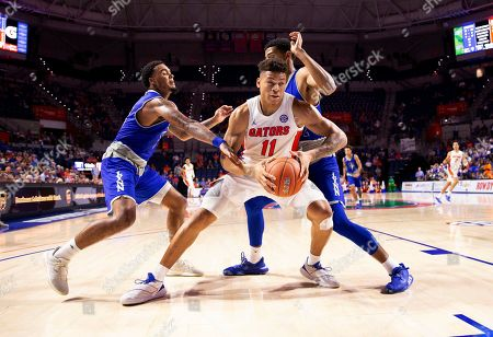Keyontae Johnson, Jordan Allen, Cameron Gaines. Florida forward Keyontae Johnson (11) drives between Lynn guard Jordan Allen, left, and forward Cameron Gaines (12) during the second half of an NCAA college basketball exhibition game, in Gainesville, Fla
