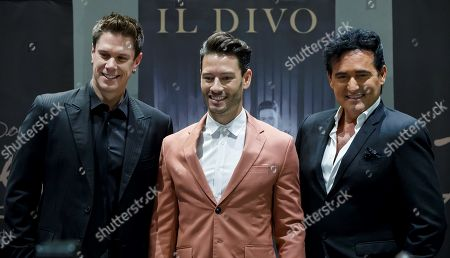The members of Il Divo, David Miller (L), Urs Buhler (C) and Carlos Marin (R), pose during a press conference in Mexico City, Mexico, 29 October 2019. An Il Divo concert in a vineyard in Coahuila, in northeastern Mexico, will be the celebration of the 15 years of the Il Divo on 01 November.
