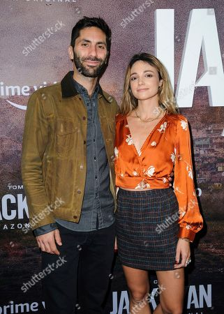 """Nev Schulman, left, and Laura Perlongo attend the premiere of Amazon Prime's """"Tom Clancy's Jack Ryan"""" season two at Metrograph, in New York"""