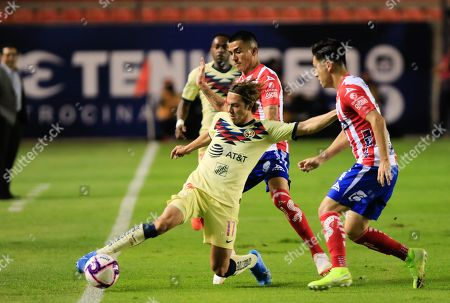 Francisco Cordoba (C) of America vies for the ball with Ian Gonzalez and Jorge Sanchez (R) of Atletico San Luis during their Apertura tournament soccer match between Atletico San Luis and America at Alfonso Lastras stadium in San Luis Potosi, Mexico, 29 October 2019.