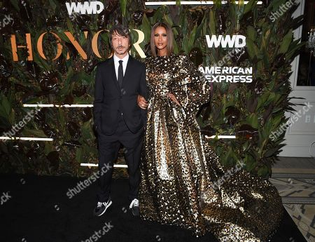 Pierpaolo Piccioli, Iman. Honoree Pierpaolo Piccioli, left, and model Iman attend the fourth annual Women's Wear Daily WWD Honors at the InterContinental Barclay, in New York
