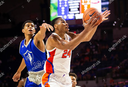Kerry Blackshear Jr., Cameron Gaines. Florida forward Kerry Blackshear Jr. (24) shoots a layup past Lynn forward Cameron Gaines (12) during the second half of an NCAA college basketball exhibition game, in Gainesville, Fla