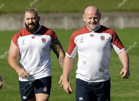 England's Joe Marler, left, and teammate Dan Cole during a training session in Tokyo, Japan, . England will play South Africa in the Rugby World Cup final on Saturday Nov. 2. in Yokohama