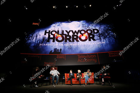 "Chris Hardwick, Dean Zimmerman, Mac Quayle, Eryn Krueger MeKash, Paul Graff, Angela Kang. From left to right, Chris Hardwick, Dean Zimmerman, Mac Quayle, Eryn Krueger MeKash, Paul Graff, and Angela Kang participate in the membership event, ""Hollywood Horror: Scaring Up an Audience for Television,"" at the Wolf Theatre at the Saban Media Center at the Television Academy, in Los Angeles"