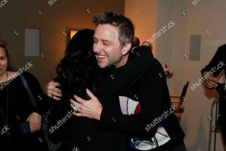 """Angela Kang, Chris Hardwick. Angela Kang, left, executive producer for """"The Walking Dead"""" and host and moderater Chris Hardwick hug in the green room at the membership event, """"Hollywood Horror: Scaring Up an Audience for Television,"""" at the Wolf Theatre at the Saban Media Center at the Television Academy, in Los Angeles"""
