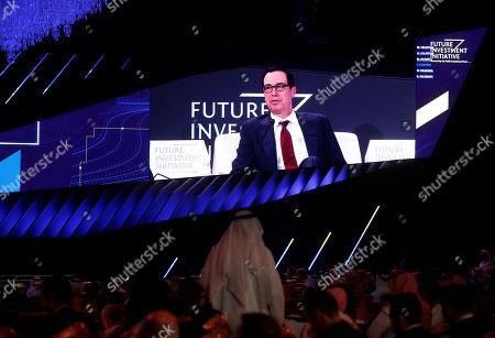 Stock Image of U.S. Treasury Secretary Steven Mnuchin is seen on a screen during his speech at the Future Investment Initiative forum in Riyadh, Saudi Arabia