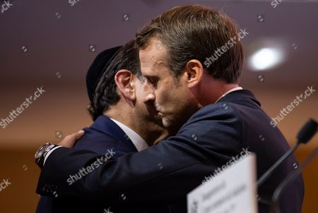 European Judaism Center inaugurated in Paris. French President Emmanuel Macron, right, hugs Central Jewish Consistory of Paris Joel Mergui during the inauguration of the Centre Europeen Du Judaisme (European Judaism Center), in Paris, Tuesday, Oct.29 2019