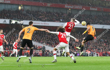 Raul Jimenez of Wolves  beats Calum Chambers of Arsenal to a header in the box