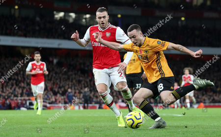 Diogo Jota of Wolves  crosses as Calum Chambers of Arsenal defends